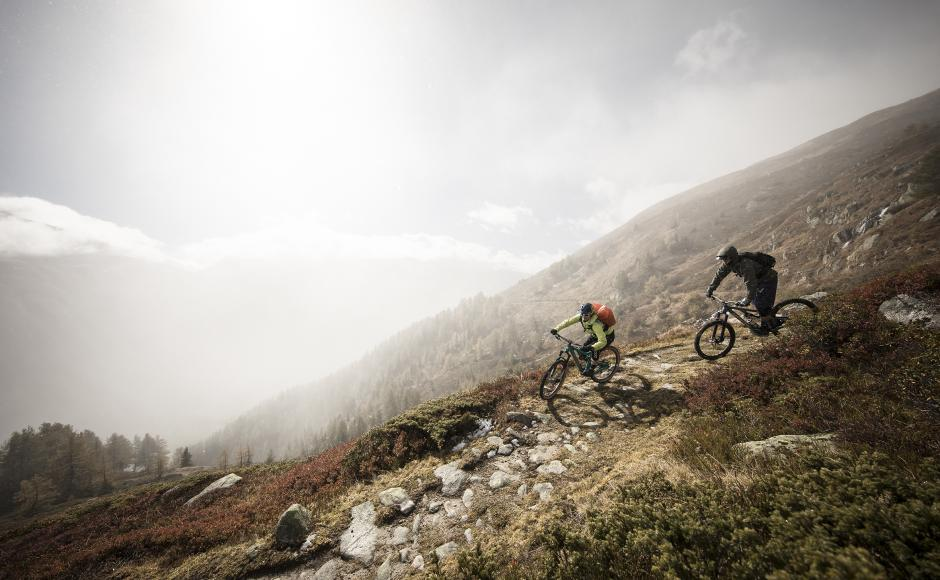 Mountainbikers on trails at the Grimsel pass, Valais