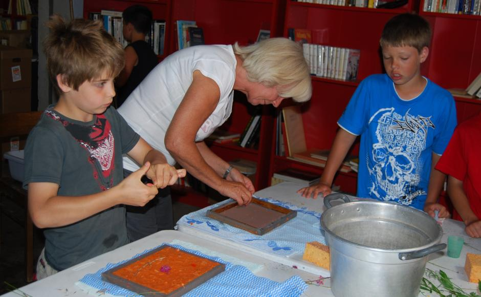 Woman doing a workshop with two children, Valais, Switzerland