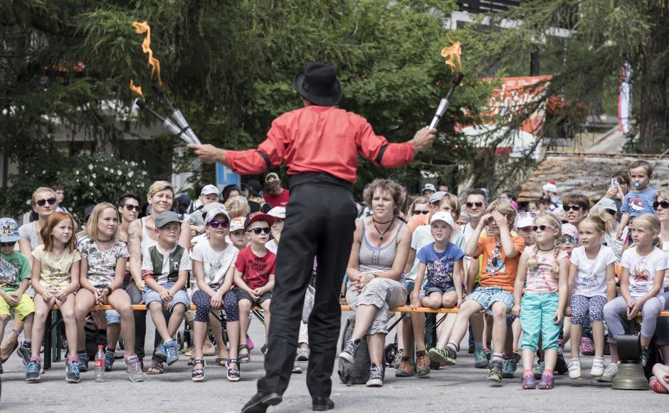 A man juggling in front of an audience at Kids Days, Valais, Switzerland