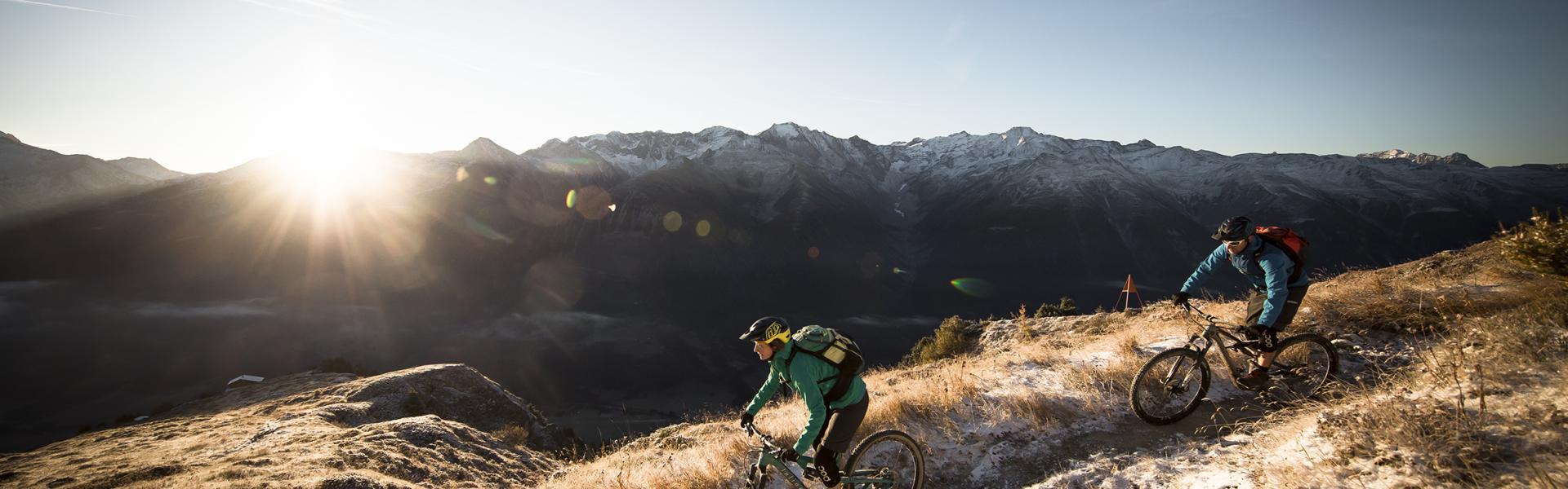 Mountain bikers riding at the Grimselpass, Valais
