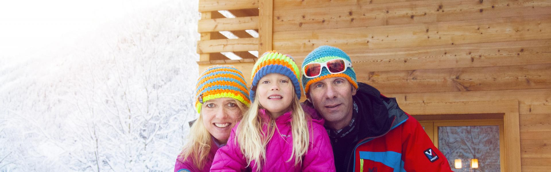Family on a terrace in winter, Valais