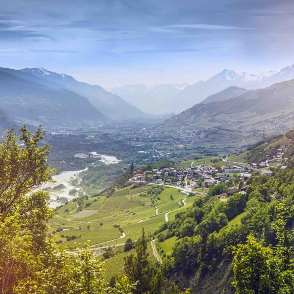 View on the Rhone Valley and wine village in summer, Valais