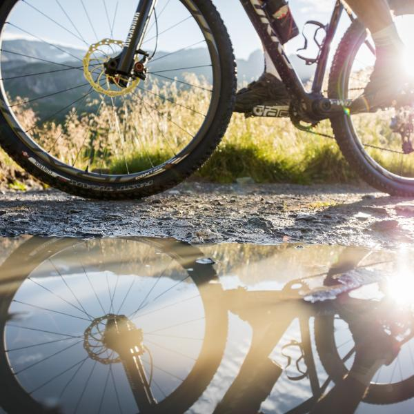 Mountainbike reflection in a puddle, Aminona, Crans-Montana, Valais