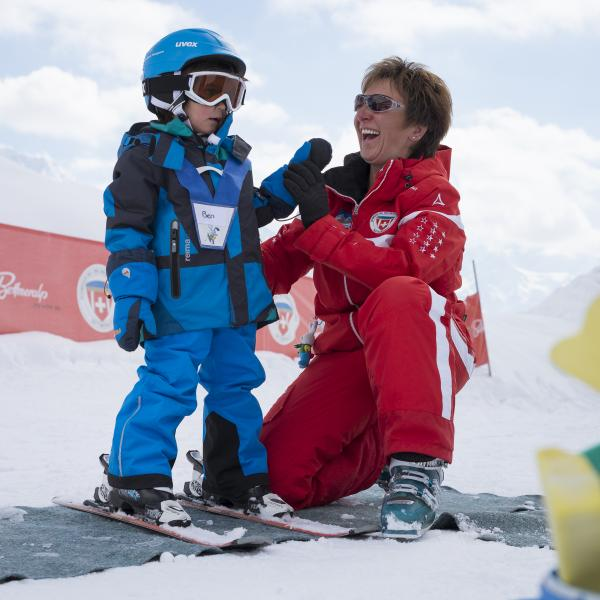 Sabine Haldemann from Bettmeralp laughs with one of her students during ski lessons