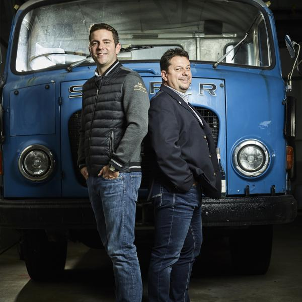 130 years Morand: Julien Morand, great-grandson of the founder, and director Fabrice Haenni (left) in front of a historic truck.
