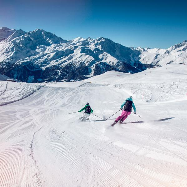 Skiers in Verbier, winter in Valais, Switzerland