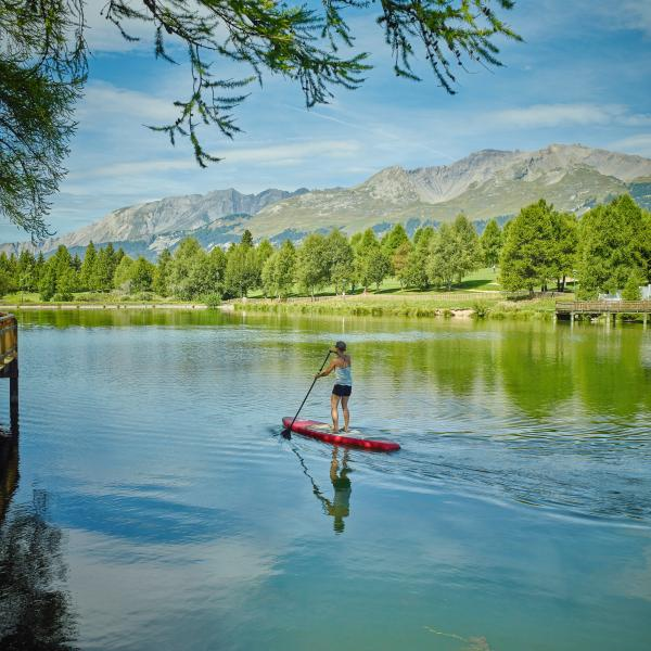 Stand up paddle in Crans-Montana, summer in Valais, Switzerland