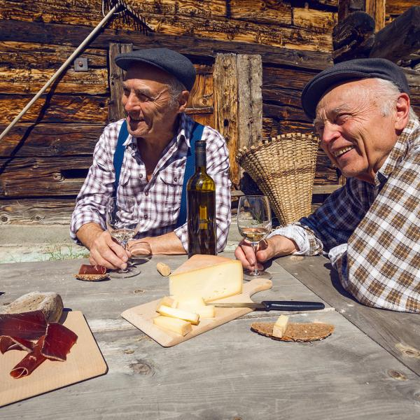 Originals eating Valais dried meat, bread and cheese in Valais