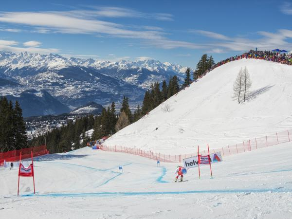 Piste Nationale in Crans-Montana. Fans are watching the race. Valais Switzerland