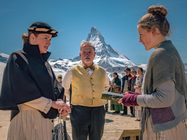 3 actors performing a theatre scene with the Matterhorn in the background, Valais Switzerland