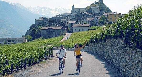 Cyclistes on the Rhone Route near to Saillon, Valais