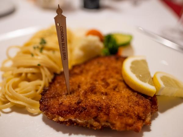 According to legend, the world-famous breaded schnitzel filled with cheese and ham was invented in a Brig restaurant. Valais cuisine, Brig, Valais, Switzerland