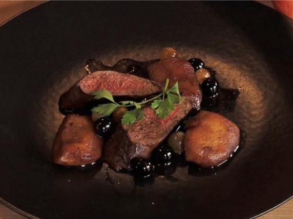 A Wild boar filet mignon with apples and grapes in a pan, Valais, Switzerland