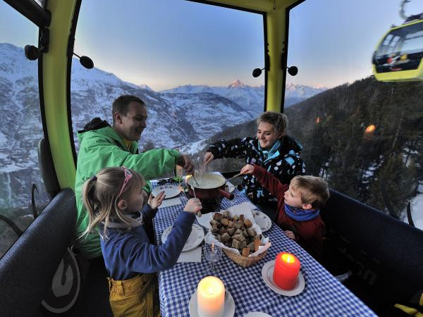 Fondue in the cable car Grächen, Family, Valais, Switzerland