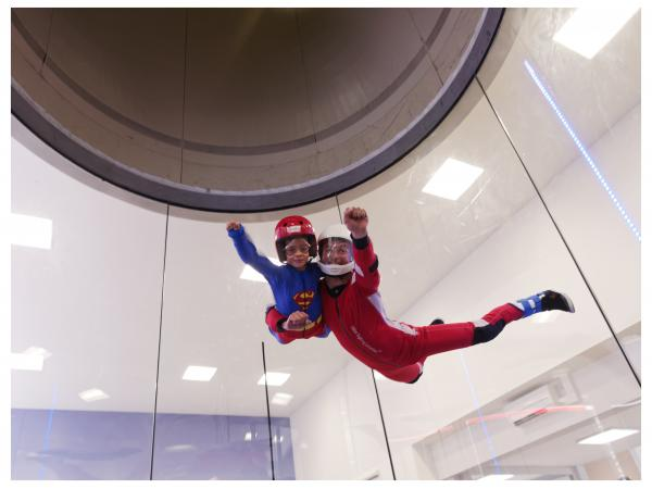 Child disguised as Superman in the Realfly, freefall simulator in Sion, Valais Wallis, Switzerland