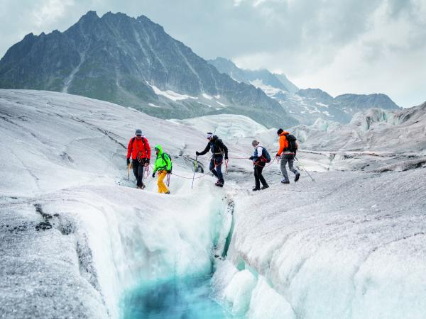Patrik Z'Brun's group walks on the Aletsch glacier with crampons and a rope. Valais. Switzerland