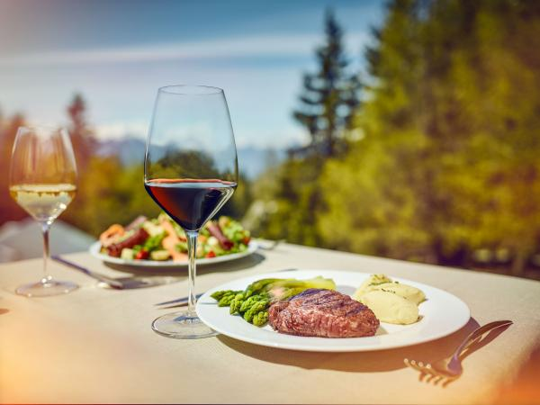 Valais meat with a glass of red wine on a terrace in the sun, Valais Brand, Wallis, Switzerland, Schweiz, Suisse